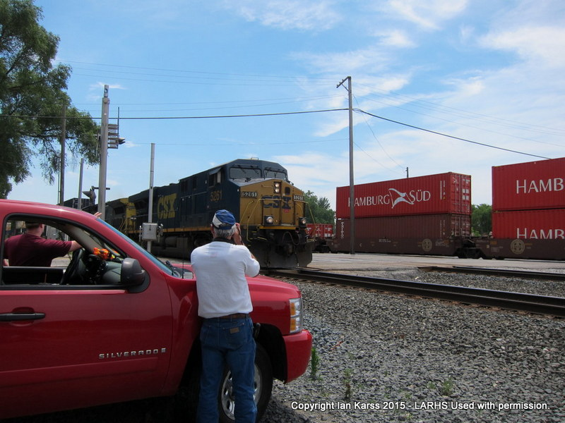 Club members photograph CSX and CN freights at Blue Island, IL.